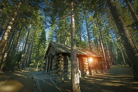 frontiers: Aged Forest Log Cabin Somewhere in Sierra Nevada Mountains, United States.