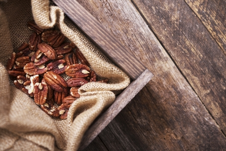 pecans: Raw Pecans in Small Wood Crate and Canvas. Top View. Stock Photo