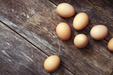 Reclaimed: Eggs on Wood Table Closeup Photo. Fresh Organic Eggs.