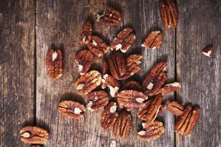 pecans: Raw Organic Pecans on Aged Wood Closeup. Stock Photo