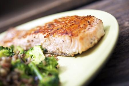 Tasty Grilled Wild Caught Salmon, Wild Rice and Broccoli Dinner Closeup. photo