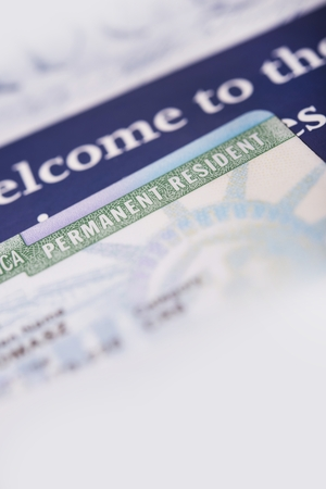immigrate: United States Green Card and Welcome Brochures Vertical Closeup Photo.