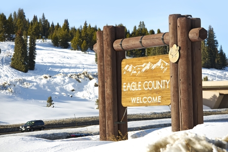 Eagle County Welcome Wooden Sign Located on Vail Pass Summit in Colorado Rocky Mountains.