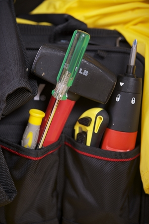 Construction Tools in Contractor Bag Vertical Photo.