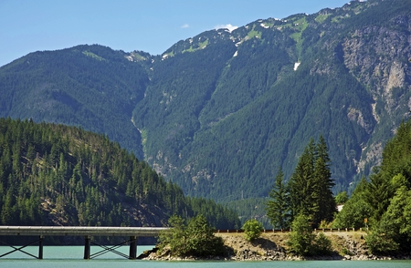 North Cascades Mountains Landscape with Bridge on the Lake. Washington State,  United States of - North Cascades Mountains Landscape With Bridge On The Lake
