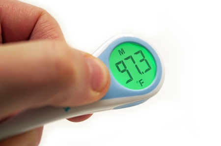 body temperature: Electronic Thermometer Indicated Right Body Temperature. Electronic Thermometer in Male Hand Isolated on White Background.