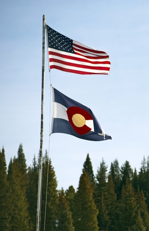 colorado state: Colorado State and United States Flags Waving on High Metal Pole.