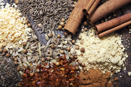 Aromatic Spices on Aged Wood Closeup