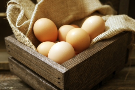 cholesterol free: Organic Cage-Free Chicken Eggs in Wooden Crate with Canvas. Stock Photo