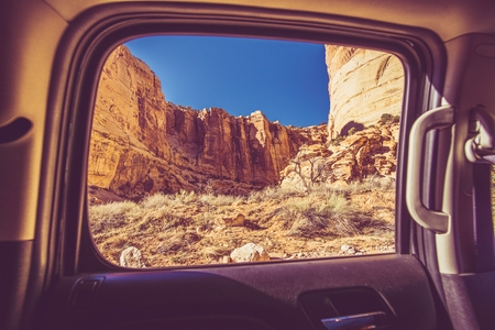 dangerous reef: Scenic Car Window View. Utah Scenery While Driving Capitol Reef National Park Canyon Road. American Journey. Stock Photo