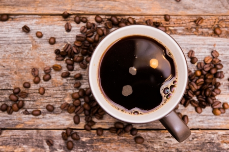 Coffee Moment. Large Brown Coffee Cup and Coffee Beans Stock Photo