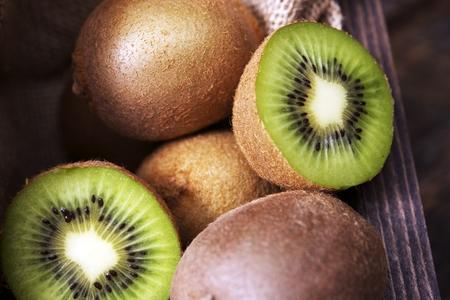 Fresh Sliced Kiwi Fruits on Wooden Table.