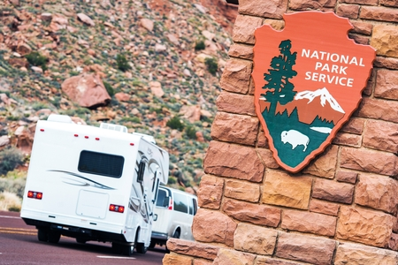 service entrance: American National Parks RV Journey. National Park Service Shield. Zion National Park Entrance. Stock Photo