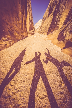 Utah Canyon Fun. Funny People Shadows in Grand Wash, Capitol Reef National Park in Utah, United States. Stock Photo