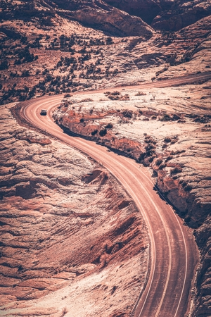 stone of destiny: Scenic Utah Curved Road in Vertical Photo. Vintage Color Grading.