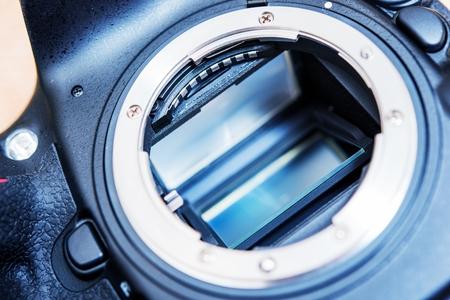 DSLR Camera Mirror. Professional Camera Mirror and Lens Mount Closeup. Camera Sensor and Mirror Cleaning. photo