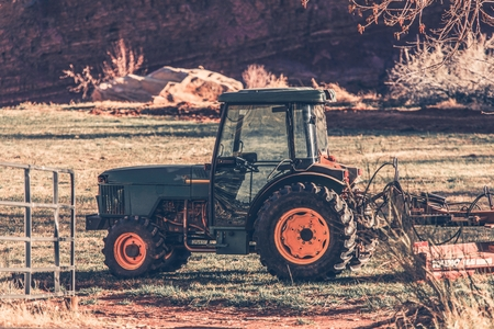 agriculture machinery: Small Tractor on the Field. Agriculture Machinery.