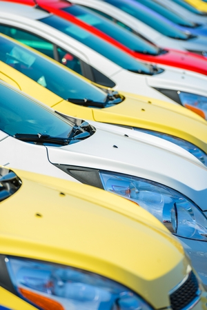 Colorful Cars Stock. Car Dealership Vehicles Stock Vertical Photography. photo