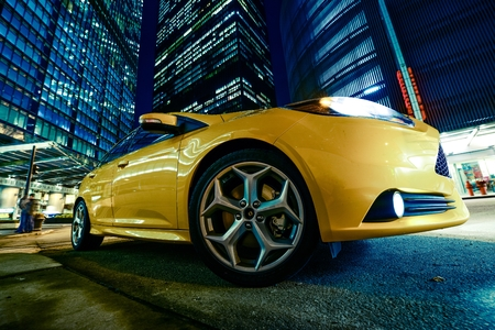 hatchback: Chicago Night Drive in Style. Yellow Sportscar in Heart of Chicago.