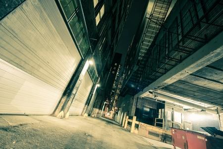 dark alley: Dark Downtown Chicago Alley at Night. Wide Angle Alley Photo.