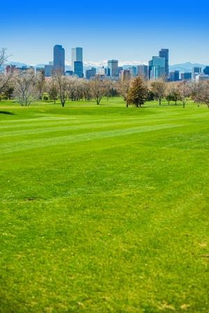 Denver Colorado USA. Spring Time in Colorado. Denver Skyline and Green Fields.  Stock Photo