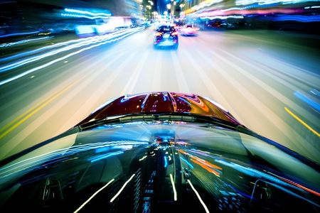 speeding car: Nightly City Traffic Motion Blurs  Colorful Urban Illumination in Motion Blur  City Streets Speeding Car
