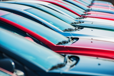 new car: Brand New Cars in Stock  Dealership Vehicles Lot  New Cars Market  Stock Photo