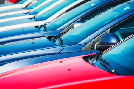 new car lot: Modern Cars in Stock  Car Dealer Brand New Cars in a Row  Stock Photo