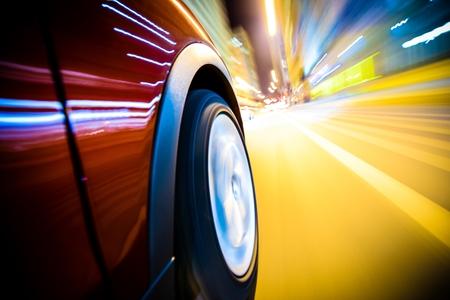 speeding: Fast Driving Car Through the City  Long Exposure Photography  Speeding Car Motion Blur Stock Photo