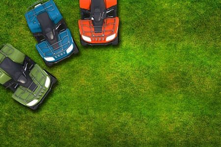 motorsport: ATV Quad Bikes on the Grassy Field - Top View Illustration with Copy Space.
