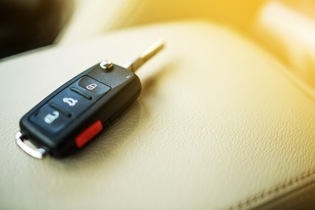 car keys: Brand New Car Keys on Leather Closeup. Cars Industry Concept. Stock Photo