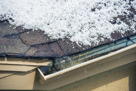 hail: Small Melting Hail on the Roof. Severe Weather Concept.