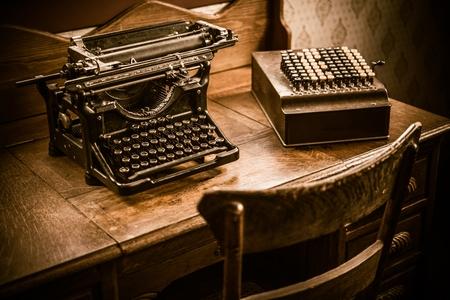Vintage Accountant Desk with Vintage Typewriter and Vintage Calculating Machine.