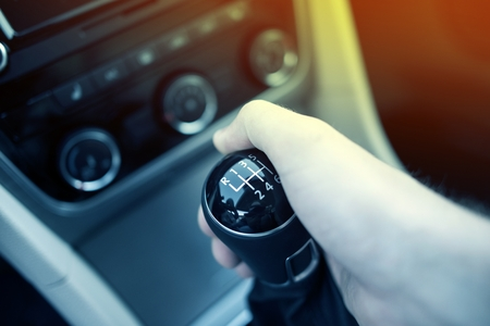 to drive: Manual Transmission Drive. Hand on Manual Transmission Car Stick. Six Speed Driving. Stock Photo