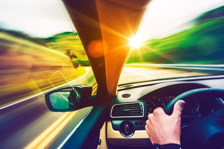 Scenic Summer Drive. Mountain Road and Sunset Scenery From the Speeding Car. Scenic Road