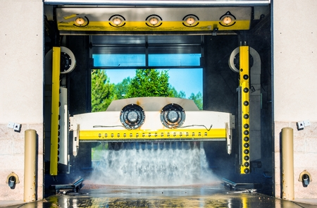 soaping: Running Touchless Carwash Photo. Car Cleaning in the Car Wash. Stock Photo