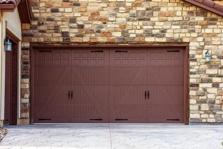 Wide Garage Doors. Brick Wall Garage. Residential Architecture. photo