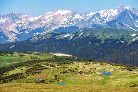 rocky mountains colorado: Colorado Rocky Mountains Panorama. Snowy Peaks and the Green Hills with Small Mountain Lakes. Colorado Landscape, United States.