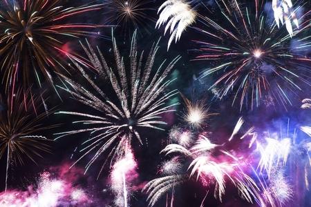 feats: Colorful Fireworks Celebration. Fireworks Background
