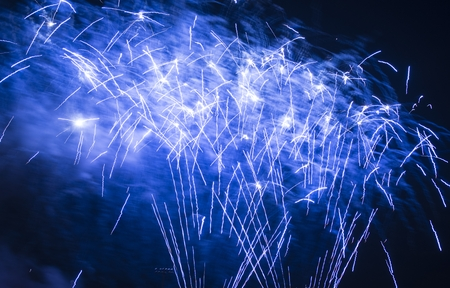feats: Bright Blue Fireworks Isolated on Black.
