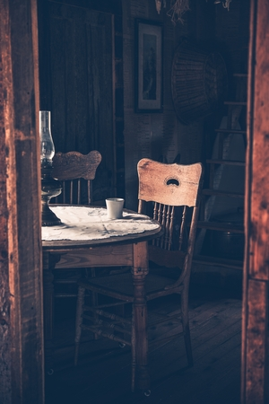 oldish: Vintage Home Interior with Old Wooden Table and Aged Chair. Retro Room with Coffee Table. Vertical Photo