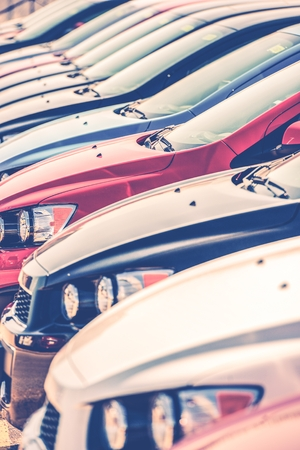 Brand New Cars in Car Dealer Stock. Cars Row Closeup. Cars Industry Concept. photo