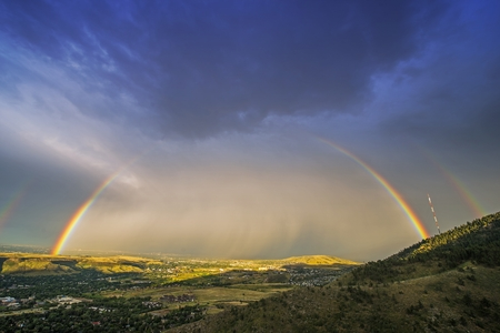 denver: Rainbow Over Denver. Colorado Stormy Sky with Colorful Full Rainbow. Scenic View From the Lookout Mountain, Golden, Colorado, United States.
