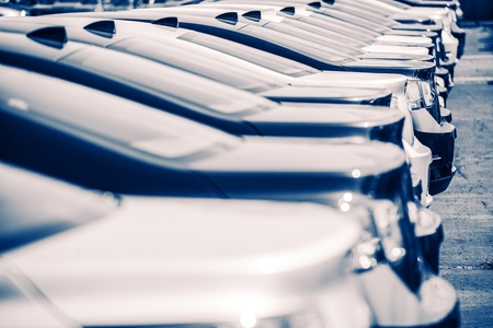 car lot: New Cars Factory Parking. Brand New Cars Awaiting New Owners. Blue Color Grading. Stock Photo