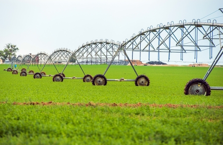 pivot: Crop Watering by Center Pivot Sprinklers Agriculture Theme. Crop Watering Equipment