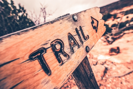 wooden trail sign: Wooden Trail Sign Closeup Photo.  Stock Photo