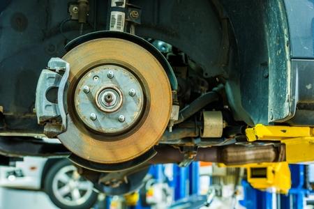servicing: Brakes Repair Auto Service. Modern Car Brakes Servicing. Car Maintenance. Auto Service.