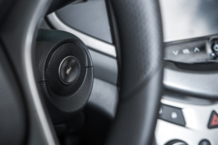 Modern Car Ignition Keyhole Closeup and Steering Wheel.  photo