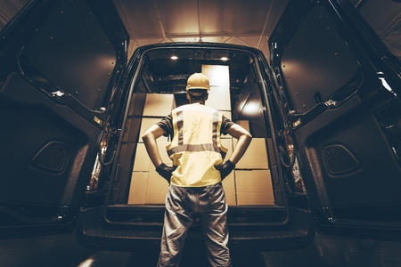 loading cargo: Large Cargo Van with Many Cardboard  Boxes Waiting For Reload. Stock Photo