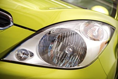 car clean: Clean Compact Car Headlight Closeup Photo.